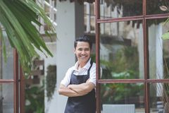 Male cafe worker smiling Stock Photography