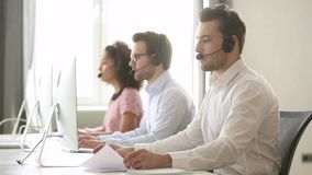 Male call center agent wear wireless headset consulting customer