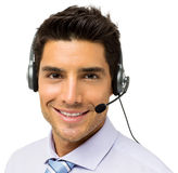 Male Call Center Representative Wearing Headset. Portrait of young male call center representative wearing headset isolated over white background. Horizontal Royalty Free Stock Images