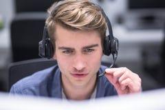 Male Call Centre Operator Doing His Job Stock Photos