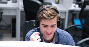 Male Call Centre Operator Doing His Job Stock Photography