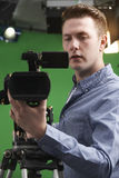 Male Camera Operator In Television Studio Royalty Free Stock Image