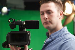 Male Camera Operator In Television Studio Stock Images