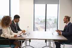Male Candidate Being Interviewed For Position In Office Royalty Free Stock Photo