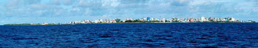 Male - capital of Maldives. Panorama. Sea view on atoll on which Male is located Royalty Free Stock Image