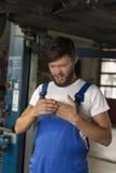 Male car mechanic injury Royalty Free Stock Photography
