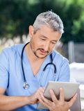 Male Caretaker Using Tablet PC Stock Photo