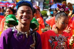 Male carnival dancer in ethnic costumes dances in delight along the road Royalty Free Stock Photography