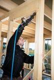 Carpenter Drilling Corner Of Wood At Site Stock Image
