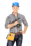 Male carpenter holding an electric drill Royalty Free Stock Image