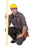 Male carpenter kneeling Stock Image