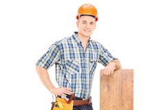 Male carpenter leaning on a plank Stock Image