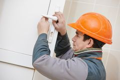 Male carpenter at lock installation Stock Image