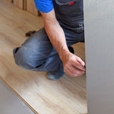 Male carpenter selects a substrate Royalty Free Stock Photo