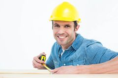 Male carpenter using measue tape Royalty Free Stock Images