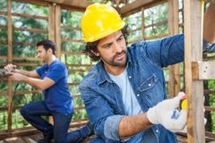 Male Carpenters Working At Construction Site Stock Images