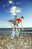 Male carrying adult female. royalty free stock images