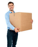 Male carrying box moving into new office Royalty Free Stock Image