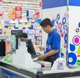 Male cashier at Coopmart supermarket in Saigon. Saigon, Vietnam - Aug 1, 2015. An unidentified cashier at Coopmart supermarket in Saigon, Vietnam Stock Photo