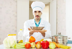 Male caucasian cook  at kitchen Royalty Free Stock Photography
