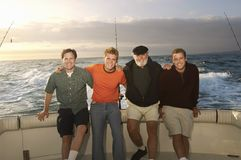 Male Caucasian Friends On Yacht Royalty Free Stock Image