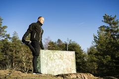 Male caucasian middle age boxer training and strething outside in nature. Male caucasian middle age boxer training outside in nature. Nice sunny winter day in Stock Photo