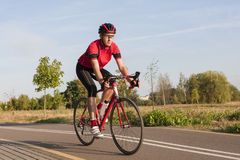 Male Caucasian Road Cyclist During Ride on Bike Outdoors. Sport and Cycling Concepts and Ideas. Male Caucasian Road Cyclist During Ride on Bike Outdoors Stock Photos