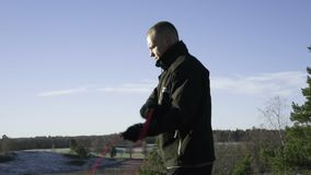 Male caucasian swedish professional boxer jumping rope outdoor in nature stock footage