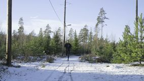 Male caucasian swedish professional boxer running outdoor in nature stock video