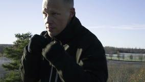 Male caucasian swedish professional boxer training outdoor in nature stock video