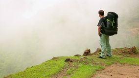 Male caucasian tourist trekking walking at himalayan mountains, Nepal Stock Photo