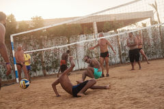 Male Caucasians, Arabs, Africans playing volleyball on the beach at sunset. Egypt. Hurghada. Golden 5 October 7, 2016. Male Caucasians, Arabs, Africans and royalty free stock photos