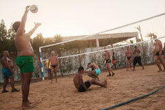 Male Caucasians, Arabs, Africans playing volleyball on the beach. Male Caucasians, Arabs, Africans and playing volleyball on the beach at sunset. Egypt. Hurghada stock photos