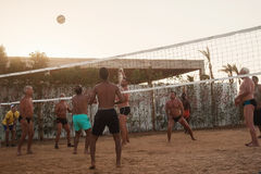 Male Caucasians, Arabs, Africans playing volleyball on the beach. Male Caucasians, Arabs, Africans and playing volleyball on the beach at sunset. Egypt. Hurghada royalty free stock photos