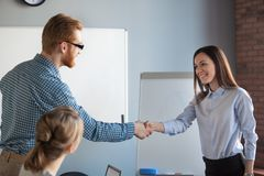 Male recruiter handshaking female job candidate after successful stock photos