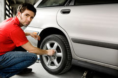 Male Changing Tire Stock Images