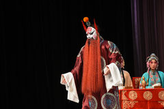 """Male character in Chinese opera with a painted face- Beijing Opera"""" Women Generals of Yang Family"""". This opera tells a patriotic story how does an Stock Photography"""
