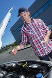 Male checking oil level car Royalty Free Stock Photos