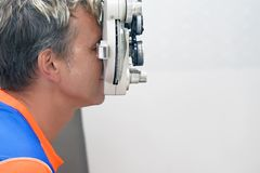 Male checks his vision on the machine royalty free stock photos