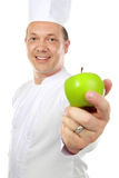 Male chef with apple Royalty Free Stock Images