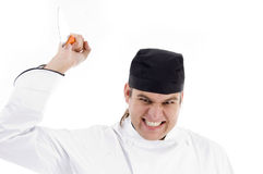 Male chef attacking with knife Royalty Free Stock Images