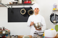Male chef at cafe's kitchen Stock Images