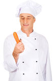 Male chef with a carrot Royalty Free Stock Photography