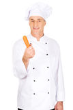Male chef with a carrot Royalty Free Stock Photo