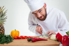 Male chef cook cutting vegetables Stock Image