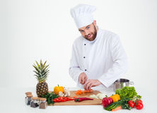 Male chef cook cutting vegetables Stock Photography