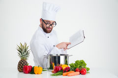 Male chef cook in glasses holding receipe book Royalty Free Stock Photo