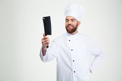 Male chef cook holding big knife cleaver. Portrait of a happy male chef cook holding big knife cleaver isolated on a white background royalty free stock images
