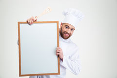 Male chef cook holding blank board. Portrait of a happy male chef cook holding blank board isolated on a white background Royalty Free Stock Images