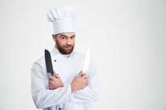 Male chef cook holding knifes Royalty Free Stock Photos